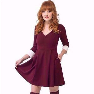 Oxblood V neck dress with cuffs and pockets